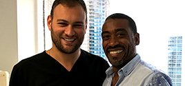 A happy Miami Back and Neck Specialists patient with Spine Surgeon Dr. Georgiy Brusovanik MD
