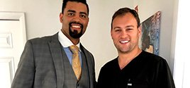 Kris Doura from Miami Dolphins visits with Spine Doctor Dr. Georgiy Brusovanik at Miami Back & Neck Specialists.